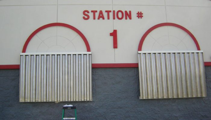 Steel Storm Panels on Firestation | Sentinel Storm Protection - Roll Down Shutters & Roll Screens in Naples and Fort Myers, Florida
